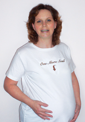 One More Soul  embroidered on with rainbow thread. 100% cotton maternity t-shirt.